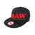 Full shot sided black fitted hat visor facing left red RAW word and natural rolling papers in brown sticker on visor