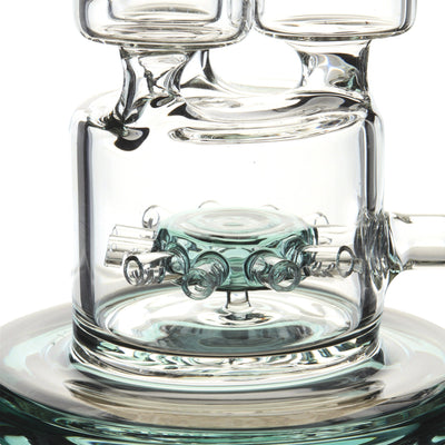 Close up shot of the teal-colored perc and half of base of 19 inch huge glass straight bong
