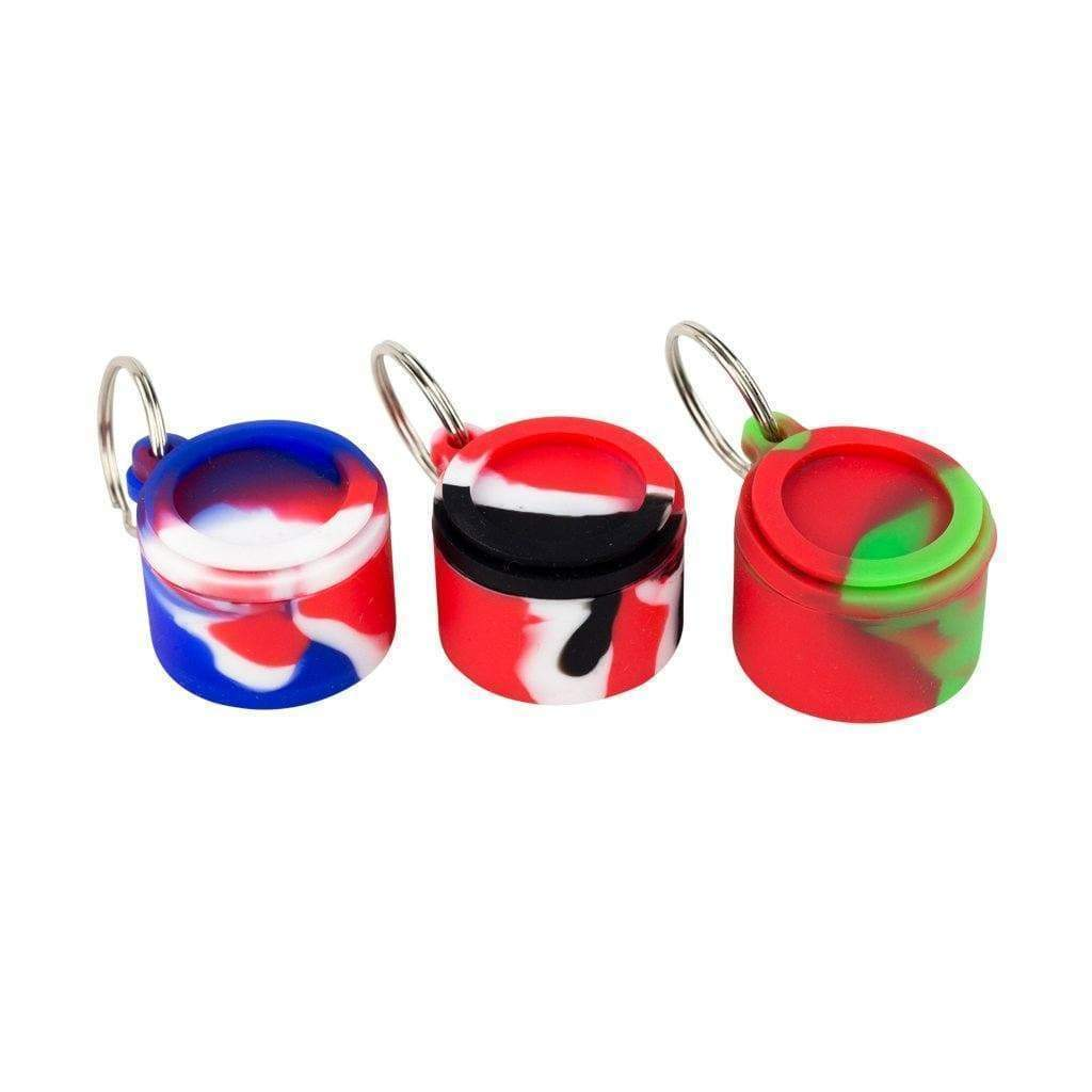 Pocket-friendly round silicone keychain wax container storage smoking accessory in swirling colors with small chain keyring