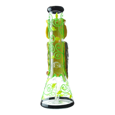 Back part of 14 inch beaker bong with owl design facing back yellow and green swirls design on neck and chamber black accents