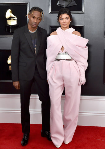 Kylie wore a pink suit, and Travis chose a black suit