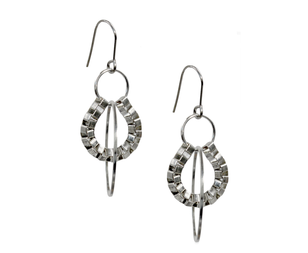 Earrings made of Box chain and silver hoops hang like a mobile.