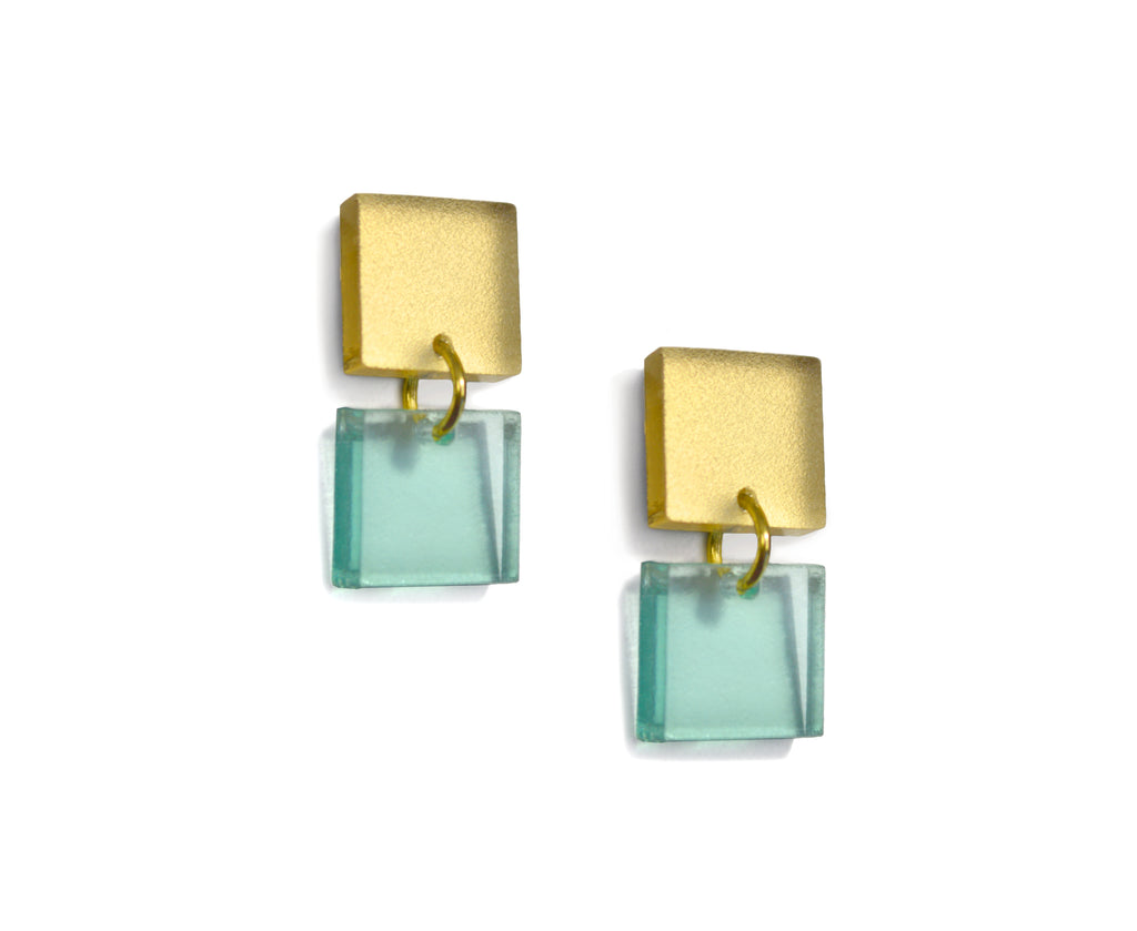 two small squares of frosted gold and glass colored acrylic are linked for small earrings