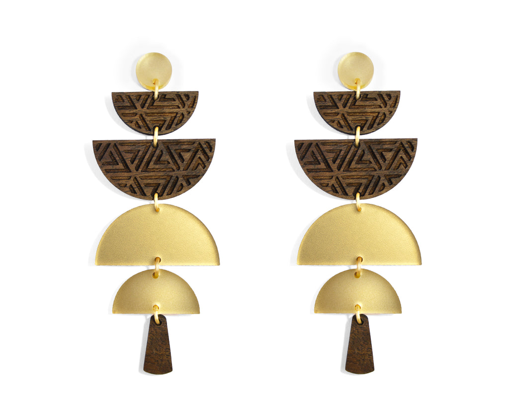 Earrings made of stacked half moon shapes etched walnut and frosted gold acrylic