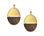 Earrings in two halves, the top is frosted gold and bottom is wood etched with a triangle pattern