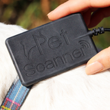 Close up PetScanner microchip reader scanning a dog