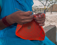 Wayuu woman crocheting a wayuu mochila bag.