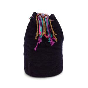 Side view of a beautiful black Wayuu Mochila Bag with a colorful strap. Strap colors are Turquoise, Bright-Pink, Tan (Light-Brown), Plum, and Black.
