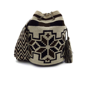 Front view of a beautiful Wayuu Mochila Bag with a pattern with flowers in colors Whey, Dark-Brown, and Black.