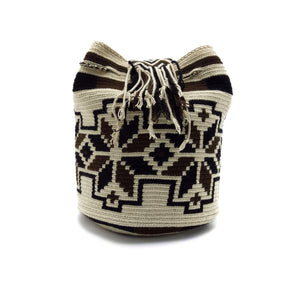 Side view of a beautiful Wayuu Mochila Bag with a pattern with flowers in colors Whey, Dark-Brown, and Black.
