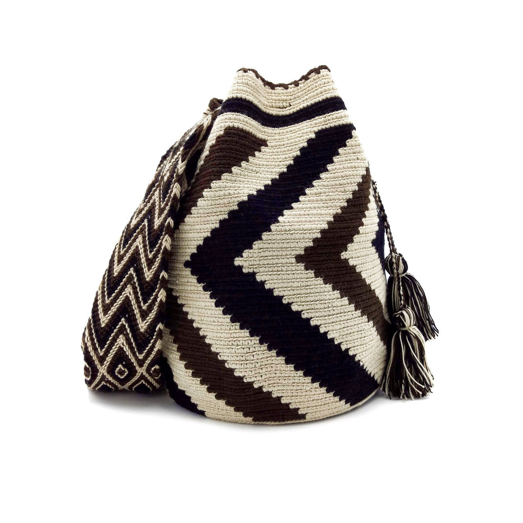 Front view of a beautiful Wayuu Mochila Bag with a pattern with zig-zags in colors Whey, Dark-Brown, and Black.