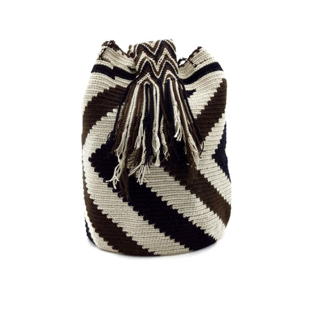 Side view of a beautiful Wayuu Mochila Bag with a pattern with zig-zags in colors Whey, Dark-Brown, and Black.