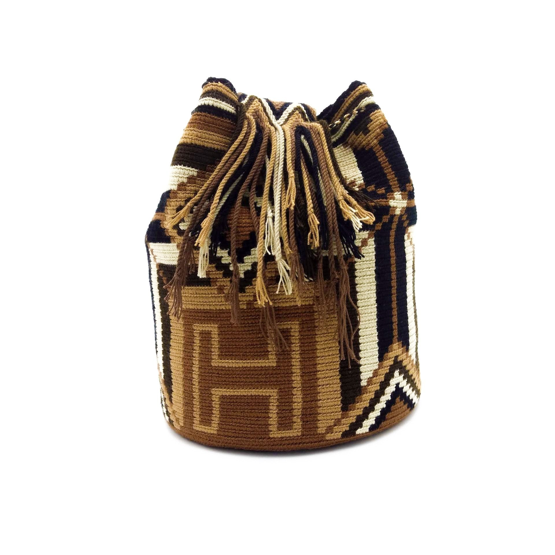 Side view of Brown-Cross Wayuu Mochila Bag with a beautiful combination of the following colors: Beige, Light Brown, Brown, Dark Brown, and Black.