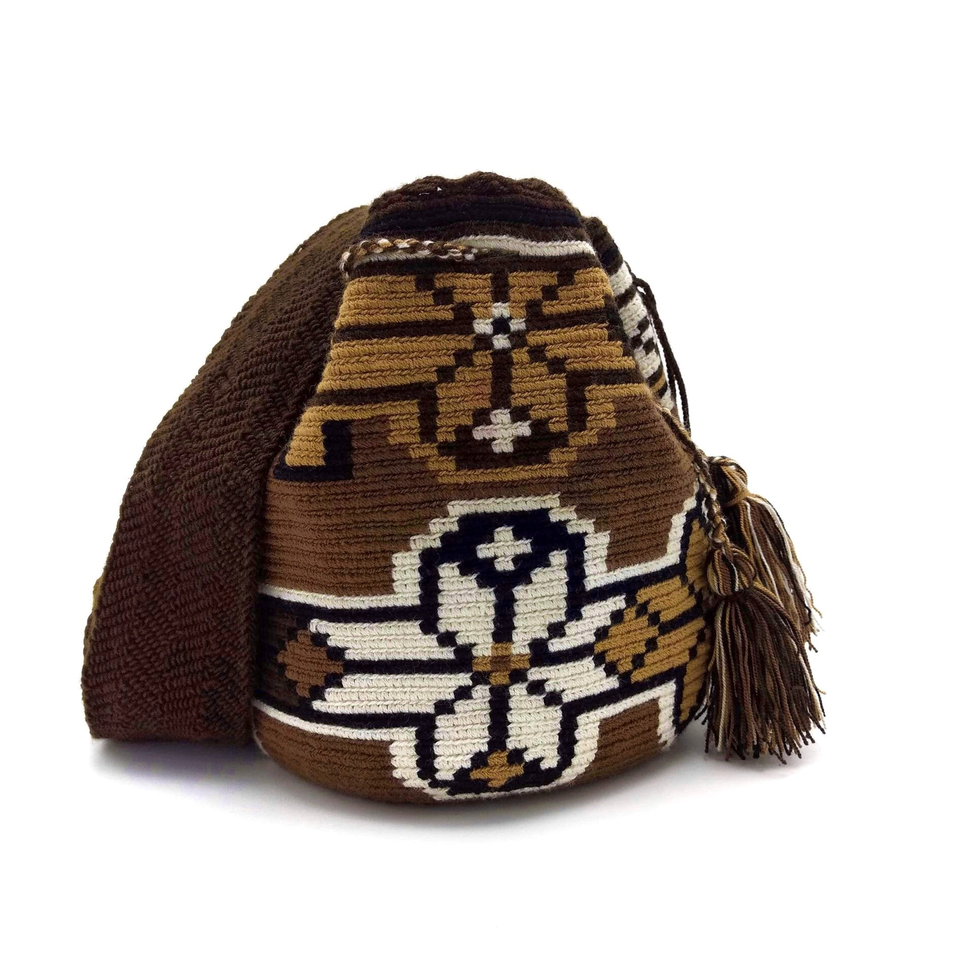 Front view of a beautiful Wayuu Mochila Bag with a great array of colors such as Beige, Black, Tan (Light-Brown) and Dark-Brown.