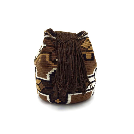 Side view of a beautiful Wayuu Mochila Bag with a great array of colors such as Beige, Black, Tan (Light-Brown) and Dark-Brown.