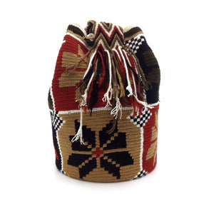 Side view of Eight-Petal Flower Wayuu Mochila Bag with beautiful pattern in the following colors: Light-brown, Ivory, Brown, Red, and Black.