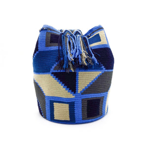 Side view of a Wayuu Mochila Bag with a geometrical pattern using an Eight Pointed Star, Rectangles and Triangles in a beautiful array of colors such as Azure Beige Gray Blue Black.