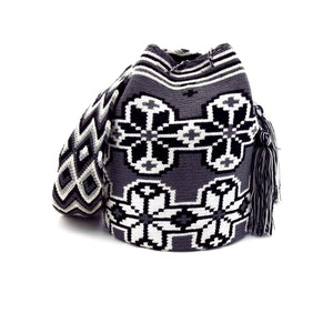 Front view of Wayuu Mochila Bag with a beautiful pattern of flowers in colors Black, White, and Gray.