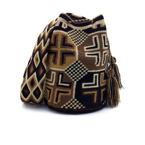 Front view of the Hazelnut Wayuu Mochila Bag with a beautiful combination of the following colors: Whey, Tan, Brown, and Black.