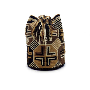 Side view of the Hazelnut Wayuu Mochila Bag with a beautiful combination of the following colors: Whey, Tan, Brown, and Black.