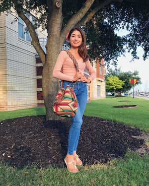 Young woman wears the beautiful Ice-Cream Wayuu Bag.