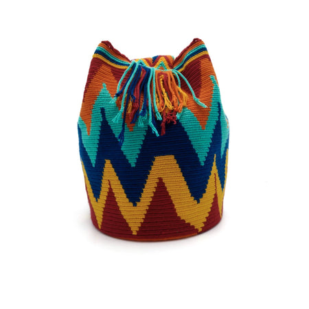 Side view of Macaw Wayuu Mochila Bag with an awesome combination of vibrant colors such as Red, Orange, Turquoise, Dark-Blue, and Dark-Yellow.