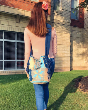 Young woman wears the beautiful Salmon-Sushi Wayuu Bag.