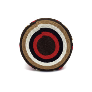 Bottom view of a beautiful Wayuu Mochila Bag with a vibrant pattern in colors Ivory, Bright-Red, Light-Brown, Dark-Brown, and Black.