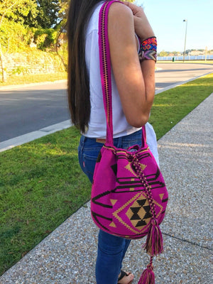 Young woman holds a beautiful one-thread Wayuu bag.