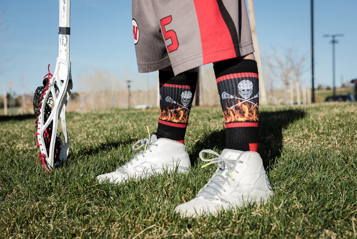 lacrosse-socks-flaming-skull