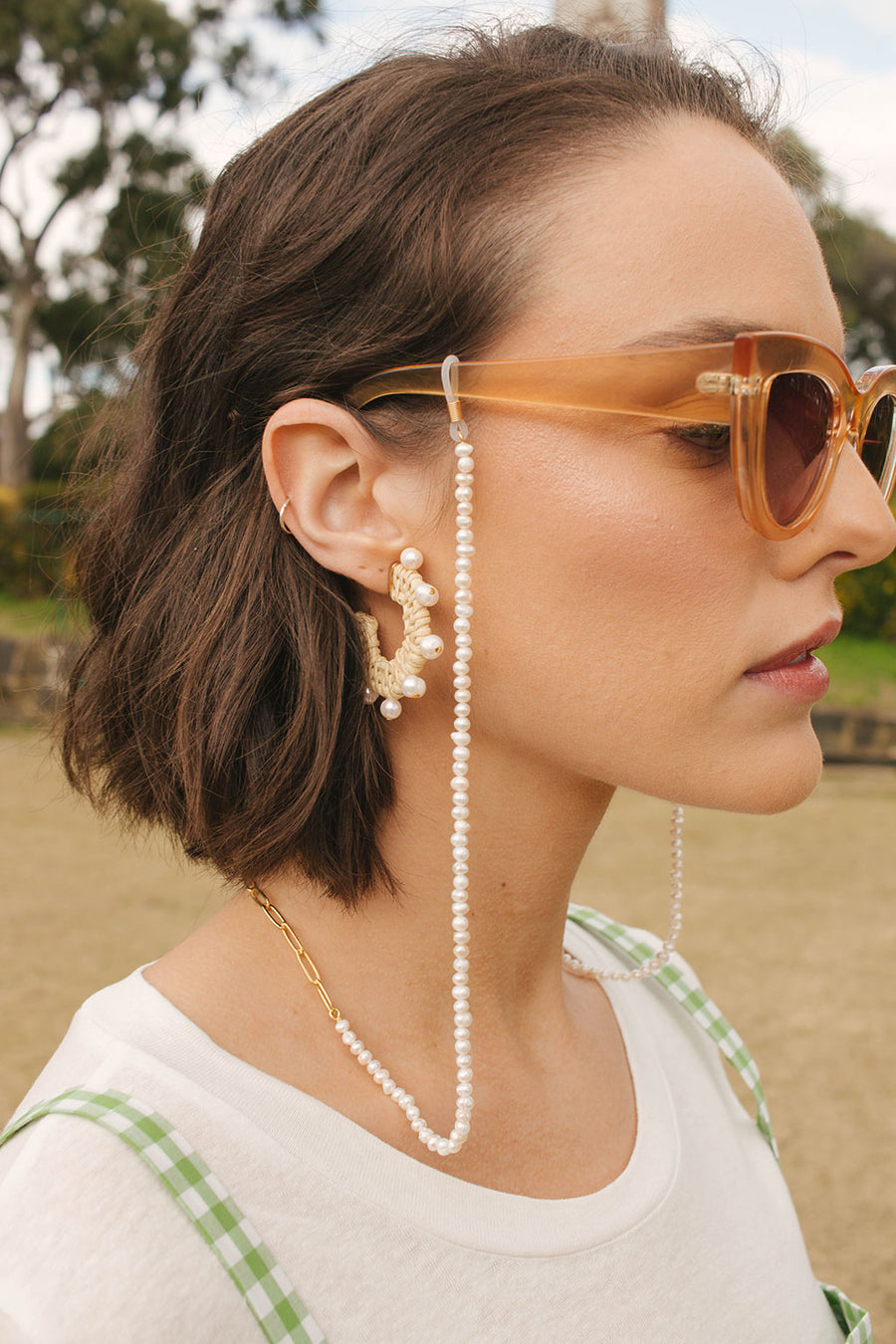 HEW Clothing Lustre glasses chain with natural iridescent freshwater pearls