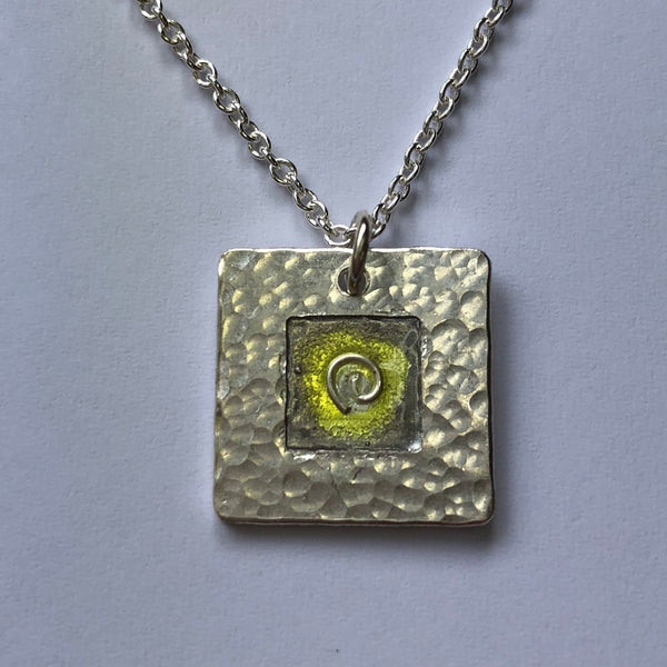 Pendant, yellow and grey koru