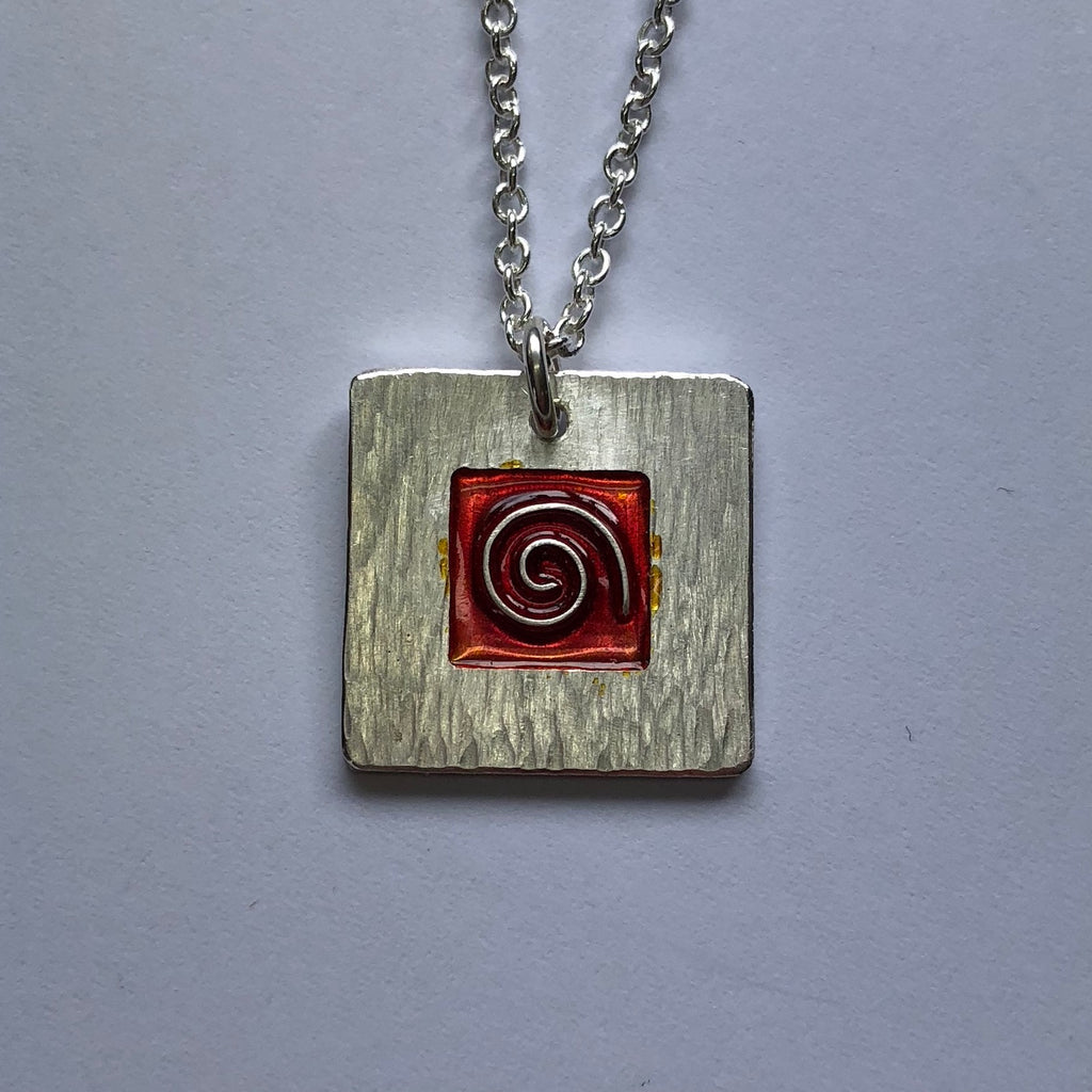 Koru pendant with red cloisonne enamel