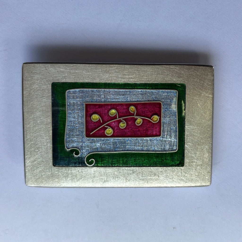 Brooch, rectangle, small leaf on red with green and blue