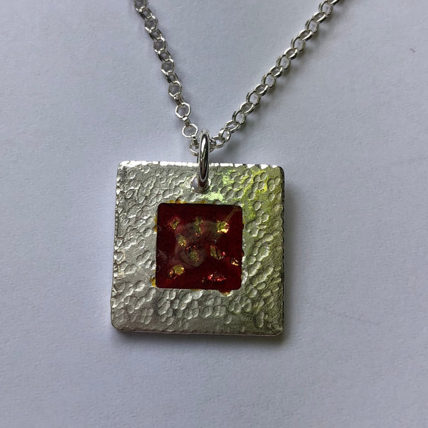 pendant, hammered fine silver with red enamel and fine gold detail
