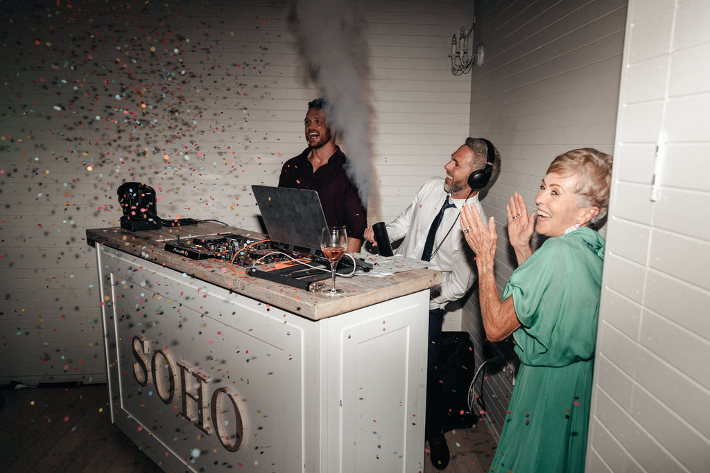 smoke canons and confetti during theis reception