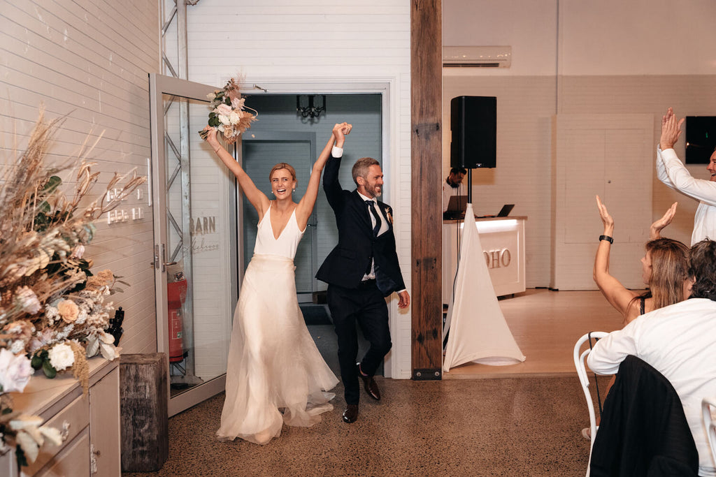 hands in the air for this wedding entrance