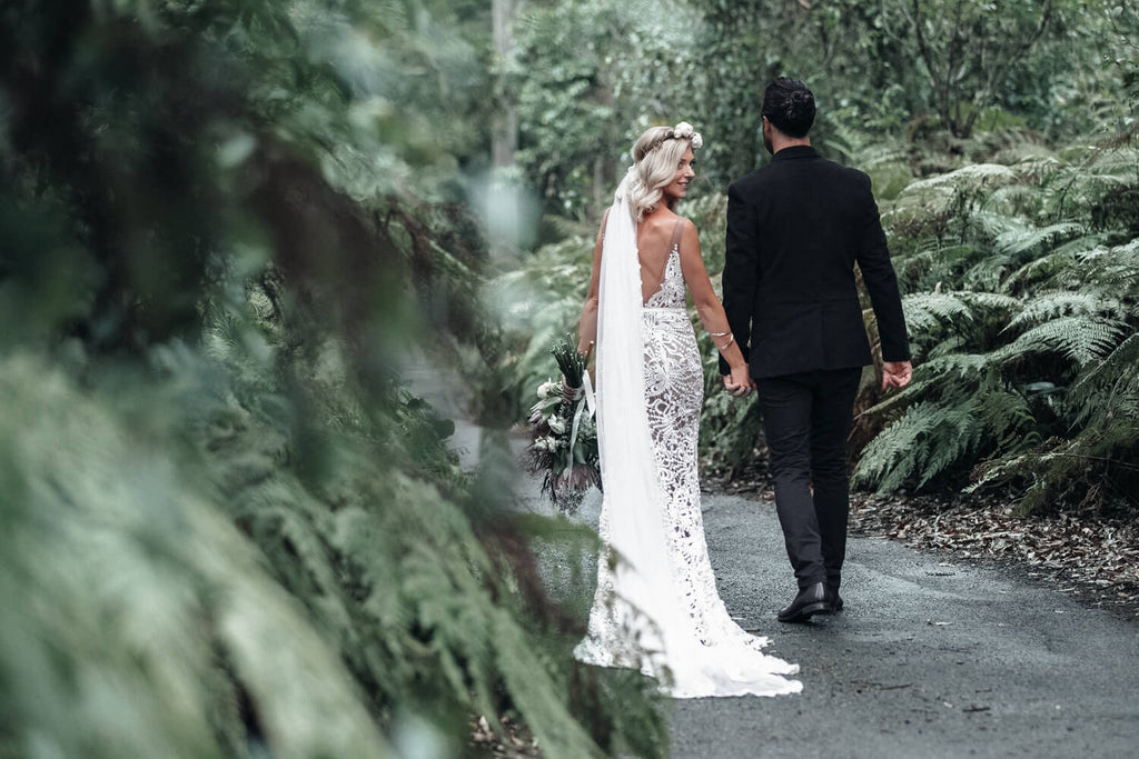 the newcastle wedding photographer captures a bride and groom walking