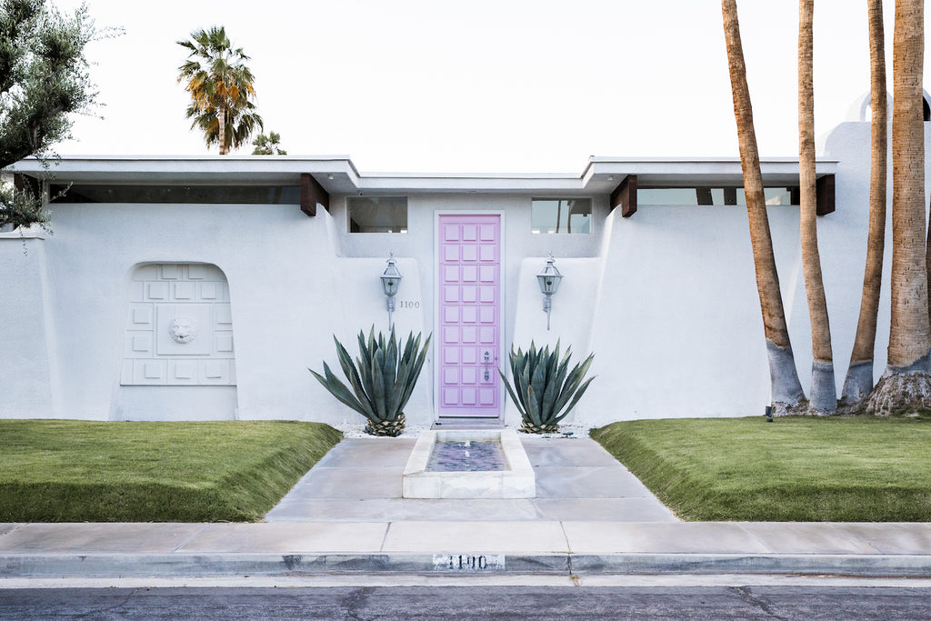 Palm Springs home with a pink door