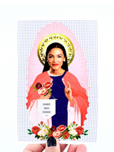 Vinyl sticker featuring a photograph of Senator, Alexandria Ocasio-Cortez that reads change takes courage.