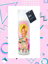 White candle featuring photo of Beyonce.