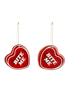 Red dangle candy heart dangle earrings that say, bite me.
