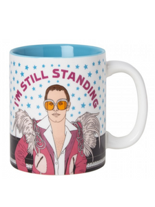 coffee mug featuring Elton John that says, I'm still standing.