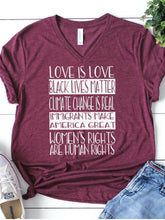Red wine colored shirt that says, Love Is Love Black Lives Matter Climate Change Is Real