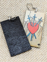 Lightweight rectangular wood earrings painted to resemble the 3 of swords card from the Rider Waite tarot deck.