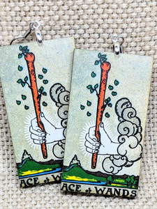Lightweight rectangular wood earrings painted to resemble the ace of wands card from the Rider Waite tarot deck.