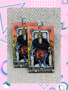 Lightweight rectangular wood earrings painted to resemble the emperor card from the Rider Waite tarot deck.
