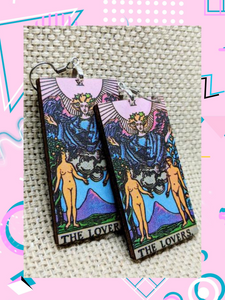 Lightweight rectangular wood earrings painted to resemble the lovers card from the Rider Waite tarot deck.