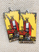 Lightweight wood earrings painted to resemble the magician card from the Rider Waite tarot deck.