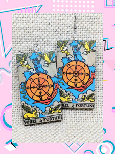 Lightweight rectangular wood earrings painted to resemble the wheel of fortune card from the Rider Waite tarot deck.